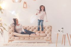 Lively sincere child making her mom laugh royalty free stock photography
