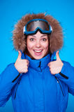 Lively skier over blue background Stock Photos