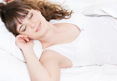 Lively sleeping woman. Portrait of lively sleeping woman in the bed Stock Photography