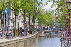 Lively street in the heart of Amsterdam, Netharlands Royalty Free Stock Photography