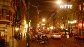 Lively Witte de Wit street during evening hours in Rotterdam. Festively decorated Witte de Wit Street in Rotterdam the Netherlands provides for a lively night stock image