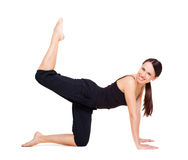 Lively woman doing exercises for legs. And buttocks. isolated on white Royalty Free Stock Image