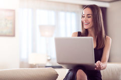 Lively woman holding laptop Stock Images