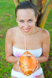 Lively young woman with coconut Stock Photography