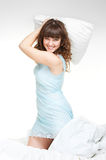 Lively young woman with pillow Royalty Free Stock Photos