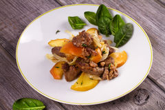 Liver with apple, spinach and onion. Liver with apple, spinach and onion Stock Image