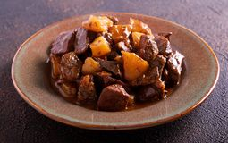 Liver and apple stew in a plate Royalty Free Stock Photo