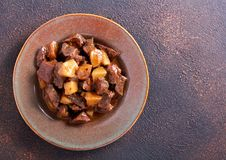 Liver and apple stew in a plate Royalty Free Stock Images
