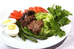 Liver with asparagus and eggs Stock Photography