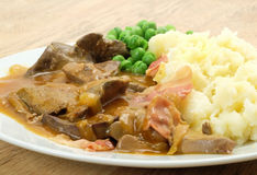 Liver and bacon with mash and peas Royalty Free Stock Photography