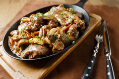 Liver baked with mushrooms, bacon and herbs Royalty Free Stock Images