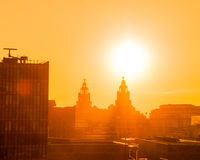 LIVER BUILDINGS AT SUNSET, LIVERPOOL, ENGLAND. stock photography