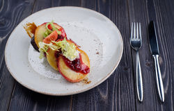 Liver with cherry sauce and apples Stock Photography