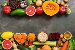 Liver detox diet food concept, border. Fruits,vegetables, nuts, olive oil, citrus fruits, green tea, turmeric, oats. Top view,