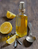 Liver Detox with olive oil and lemon fruits. On the wooden table stock photo