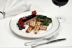 Liver foie gras with croutons and berries Stock Image