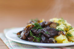 Liver fried with boiled potatoes Royalty Free Stock Photo