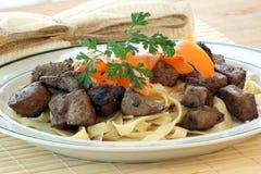 Liver goulash on pasta Stock Image