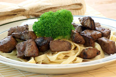 Liver goulash on pasta Royalty Free Stock Photo