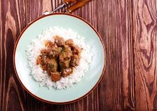 Liver in gravy with rice. On plate royalty free stock image