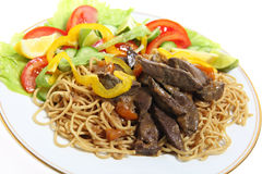 Liver on noodles angled Royalty Free Stock Photography