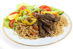 Liver and noodles with salad Royalty Free Stock Images