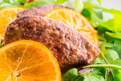 Liver with onion-orange. Sauce Royalty Free Stock Photos