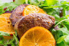 Liver with onion-orange sauce Stock Images