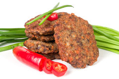 Liver pancakes or cutlets with chili pepper and green onions isolated on white background Stock Photos