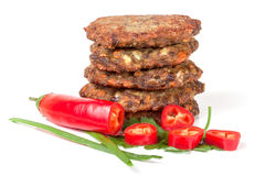 Liver pancakes or cutlets with chili pepper and green onions isolated on white background Stock Image