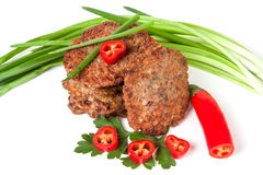 Liver pancakes or cutlets with chili pepper and green onions isolated on white background.  Royalty Free Stock Photos
