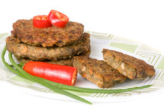 Liver pancakes or cutlets with chili pepper and green onions  on white background.  Royalty Free Stock Images