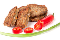 Liver pancakes or cutlets with chili pepper and green onions  on white background.  Royalty Free Stock Photos