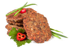 Liver pancakes or cutlets with chili pepper parsley and green onions isolated on white background.  Stock Images