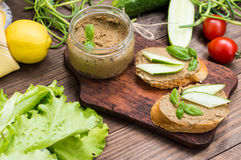 Liver pate with baguette. On a wooden rustic background. Close-up. Liver pate with baguette. On a wooden rustic background Stock Photos