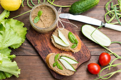 Liver pate with baguette. On a wooden rustic background. Close-up. Liver pate with baguette. On a wooden rustic background Stock Images