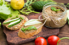 Liver pate with baguette. On a wooden rustic background. Close-up. Liver pate with baguette. On a wooden rustic background Stock Photo