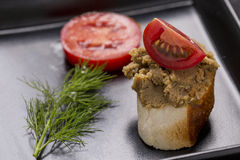 Liver pate on bread decorated with fresh vegetables decorated on Royalty Free Stock Images