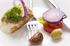 Liver pate on bread decorated with fresh vegetables decorated on Stock Photography