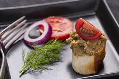 Liver pate on bread decorated with fresh vegetables decorated on Stock Photos