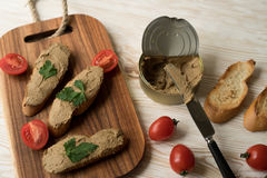 Liver pate on the bread on wooden tray. Stock Images