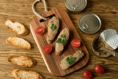 Liver pate on the bread on wooden tray. Stock Image
