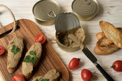 Liver pate on the bread on wooden tray. Stock Photos