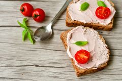 Liver pate. Breakfast from organic bio cherry tomatoes, delicious liver pate meat spreadon whole wheat bread stock photos