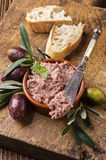 Liver pate. Meat pate with Baguette on old cutting board Royalty Free Stock Photos