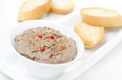 Liver pate with pink pepper in a white bowl and toasted bread Royalty Free Stock Image