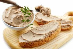 Liver pate. Sandwich with liver pate on wooden cutting board stock photos