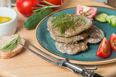 Liver patties with vegetables Royalty Free Stock Images