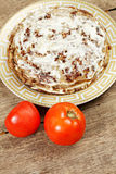 Liver pie with tomatoes above view Royalty Free Stock Images