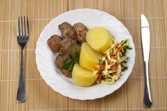 Liver, potato and salad Stock Photos